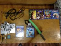Playstation 2 Slim + 6 igra  + 2 kontrolera+ kamera