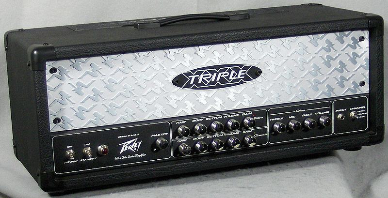 Guitar player honors the peavey triple xxx ii amp