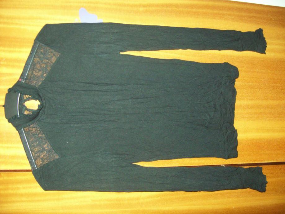 Prodajem zensku majcu.Marke;MISS SELFINDGE(6).Broj;34.